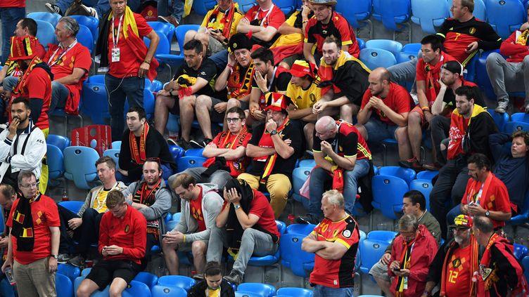 Des supporters belges dans les gradins du stade de Saint-Petersbourg, après la défaite de leur équipe, le 10 juillet 2018. (FRANCOIS XAVIER MARIT / AFP)