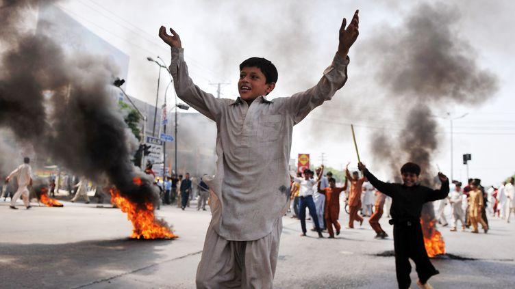 Des enfants manifestent contre le film islamophobeà Rawalpindi, dans le Pendjab (Pakistan), le 21 septembre 2012. (AAMIR QURESHI / AFP)