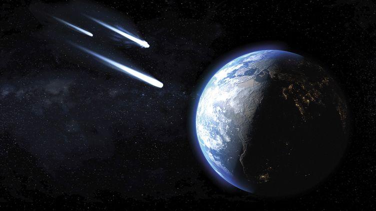 Des comètes de glace entrant dans l'atmosphère près de la Terre. (Illustration) (GETTY IMAGES / SCIENCE PHOTO LIBRARY)