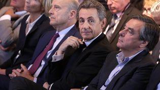 Alain Juppé, Nicolas Sarkozy et François Fillon assistent à un meeting des Républicains pour les élections régionales, à Nogent-sur-Marne, le 27 septembre 2015. (MAXPPP)