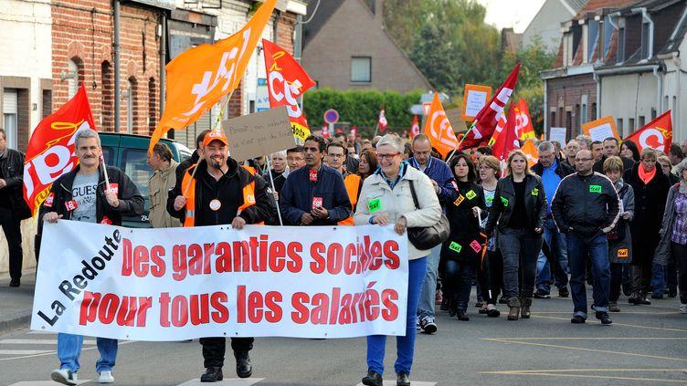 Des salariés de La Redoute manifestent, le 22 octobre 2013, à Roubaix (Nord), pour demander des garanties avant la cession de leur entreprise. (PHILIPPE HUGUEN / AFP)