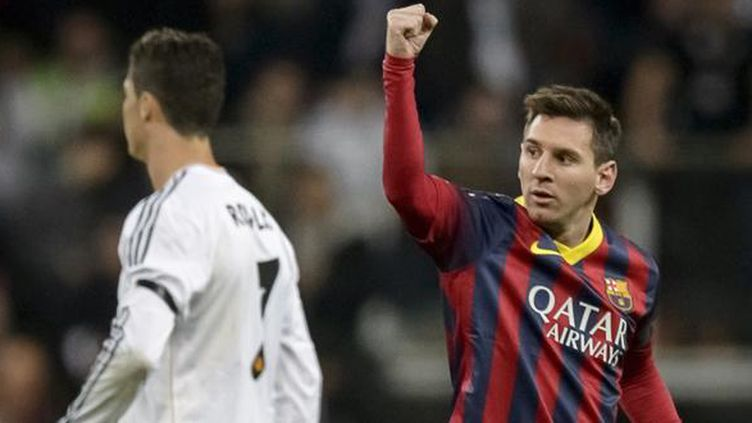 Lionel Messi et Christiano Ronaldo, le 22 mars 2015. (DANI POZO / AFP)