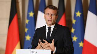 Emmanuel Macron s'exprime lors d'une conférence de presse commune avec Angela Merkel, le 13 octobre 2019 à l'Elysée. (LUDOVIC MARIN / AFP)