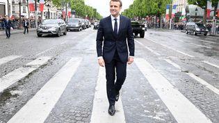 Le président de la République Emmanuel Macron sur les Champs-Elysées, le 14 mai 2017 à Paris. (ALAIN JOCARD / AFP)