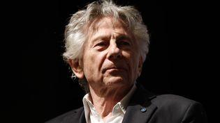 """Le réalisateur Roman Polanski sur scène après la première de son film """"J'accuse"""", à Paris, le 4 novembre 208. (THOMAS SAMSON / AFP)"""