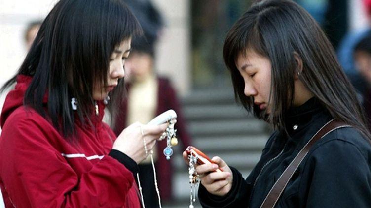 L'opérateur téléphonique China Mobile compte 17 millions de clients. (AFP PHOTO/GOH CHAI HIN)
