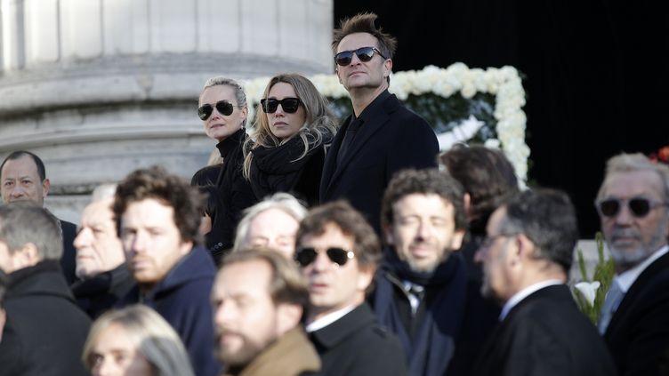 Laeticia Hallyday, Laura Smet et David Hallyday, lors de l'hommage à Johnny Hallyday à Paris, le 9 decembre 2017. (YOAN VALAT / AFP)