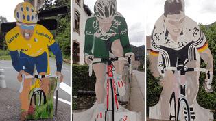 Des panneaux de bois à l'effigie d'anciens coureurs du Tour de France, comme l'Allemand Jan Ullrich (à droite), dans les rues de Plancher-les-Mines (Haute-Saône), le 23 juin 2015. (PIERRE GODON / FRANCETV INFO)