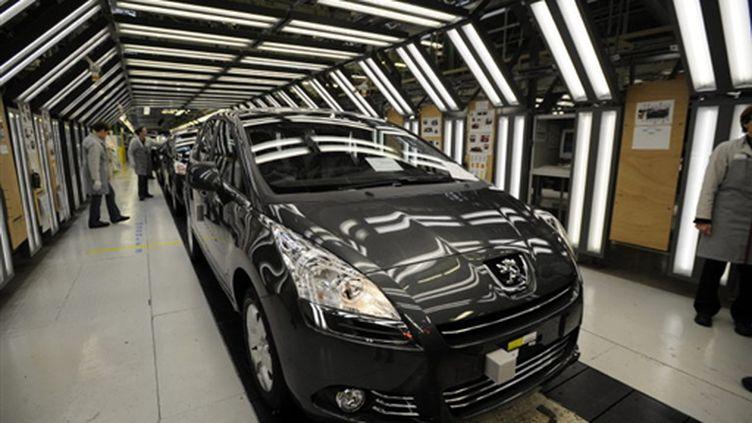 Sur une chaîne de l'usine Peugeot de Monbéliard (Doubs) (AFP - SEBASTIEN BOZON)