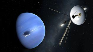 La sonde Voyager repésentée à proximité de Saturne. (MARK GARLICK/SCIENCE PHOTO LIBRA / MGA)