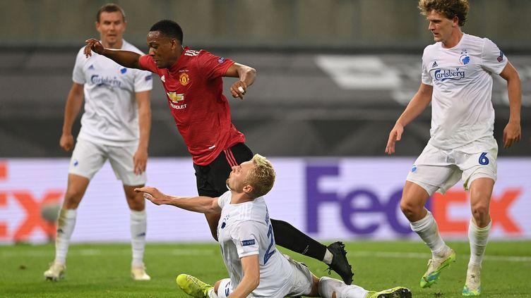 Continuant sur la lancée de sa fin de saison, Anthony Martial a longtemps buté sur Karl-Johan Johnsonn avant de sauver Manchester United en 1/4 de finale contre Copenhague en provoquant un penalty transformé par Bruno Fernandes (SASCHA STEINBACH / POOL)