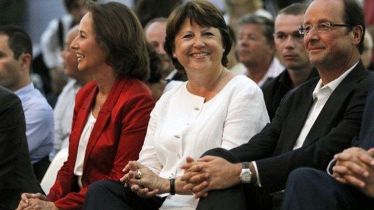 Ségolène Royal (G), Martine Aubry (C) et François Hollande à La Rochelle le le 28 août 2011 (AFP PHOTO / PATRICK KOVARIK)