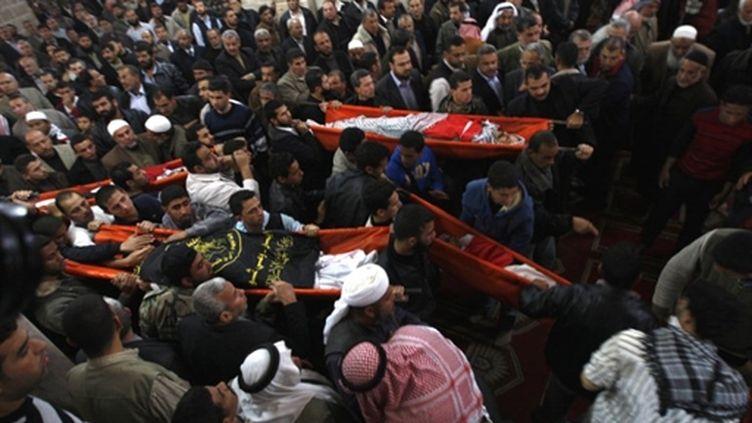 Obsèques de victimes d'un bombardement israélien à Gaza le 23 mars 2011 (AFP/SAID KHATIB)