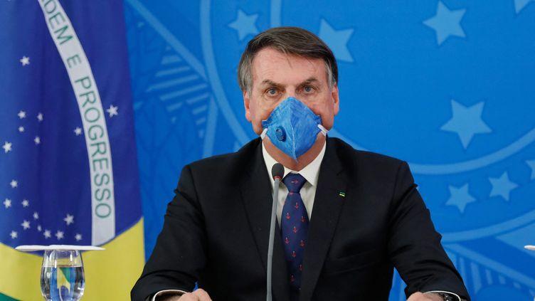 Le président brésilien Jaïr Bolsonaro lors d'une cpnférence de presse à Brasilia le 20 mars 2020 (ISAC NOBREGA / HANDOUT / MAXPPP)