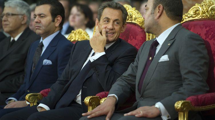 Nicolas Sarkozy et le roi du Maroc, Mohammed VI, à Tanger, le 29 septembre 2011. (LIONEL BONAVENTURE / AFP)