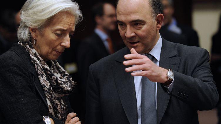 La directrice du FMI, Christine Lagarde,et le ministre de l'Economie et des Finances, Pierre Moscovici, le 24 mars 2013 à Bruxelles (Belgique). (JOHN THYS / AFP)