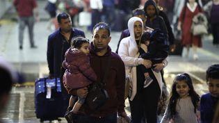 180 migrants demandeurs d'asile ont été débarqués ce 21 octobre dans le Port du Pirée près d'Athènes en Grèce (YANNIS KOLESIDIS / MAXPPP)