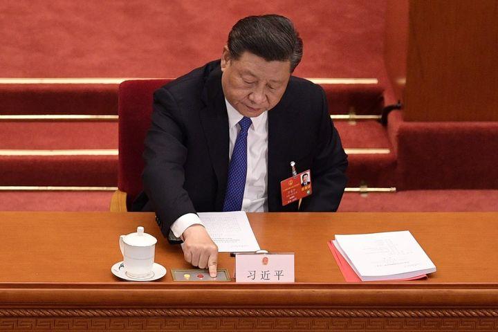 Le président chinois, Xi Jinping, lors du vote sur la sécurité nationale pour Hong Kong, le 28 mai 2020 au Palais du peuple, à Pékin. (NICOLAS ASFOURI / AFP)