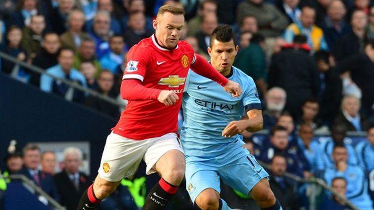 Duel de stars entre Wayne Rooney (United) et Sergio Agüero (City) (PAUL ELLIS / AFP)