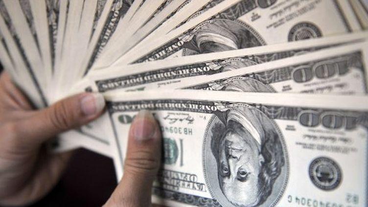 Des dollars (AFP)