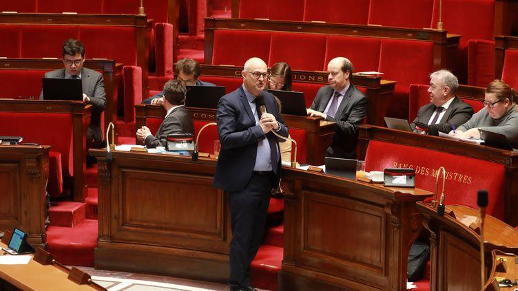 Le secrétaire d'Etat chargé des retraites,Laurent Pietraszewski, s'adresse aux députés, lundi 24 février à l'Assemblée nationale. (LUDOVIC MARIN / AFP)