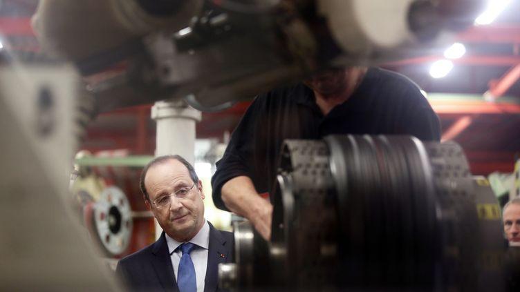 François Hollande, le 18 avril 2014, à Cebazat (Puy-de-Dôme), près de Clermont-Ferrand. (PHILIPPE WOJAZER / POOL)