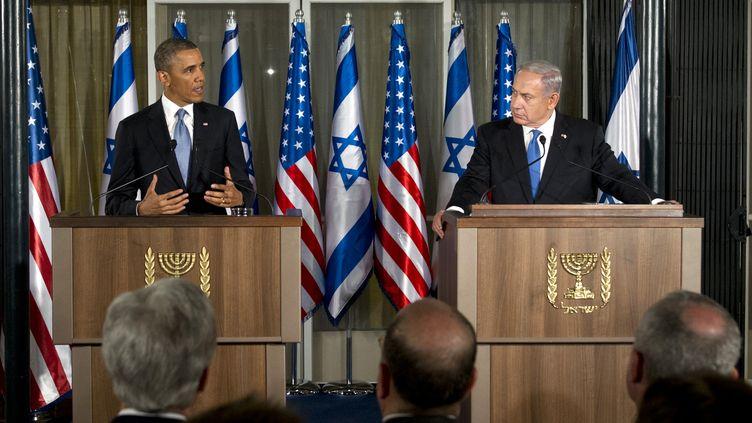 Barack Obama le 20 mars 2013 lors d'une conférence de presse commune avec le Premier ministre israélien Benjamin Netanyahu à Jérusalem. (SAUL LOEB / AFP)