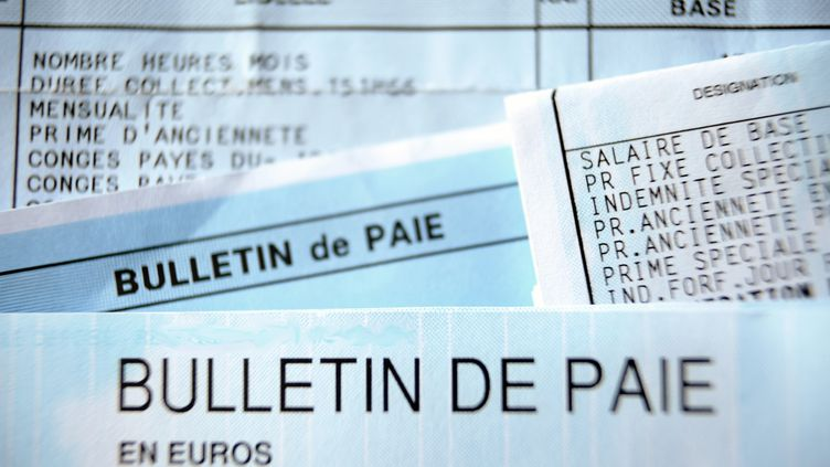 SMIC : la hausse de salaire annoncée par Emmanuel Macron pourrait être retardée (PHILIPPE HUGUEN / AFP)