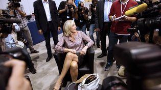 Marine Le Pen, présidente du Front national, aux universités d'été du parti à Marseille (Bouches-du-Rhône), le 14 septembre 2013. (BERTRAND LANGLOIS / AFP)