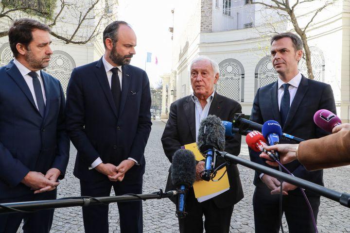 Christophe Castaner, ministre de l'Intérieur, Édouard Philippe, Premier ministre, Jean-François Delfraissy, président du conseil scientifique, et Olivier Véran, ministre de la Santé, le 13 mars 2020. (LUDOVIC MARIN / AFP)