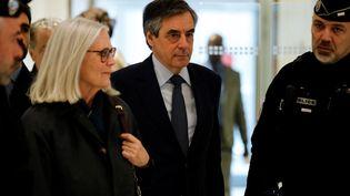 François et Penelope Fillonlors de leur arrivée au tribunal de grande instance de Paris, le 10 mars 2020. (THOMAS SAMSON / AFP)