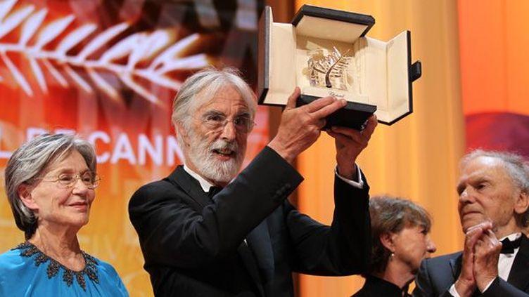 Emmanuelle Riva, Michael Haneke et Jean-Louis Trintignant recevant la Palme d'or à Cannes en 2012  (VALERY HACHE/AFP)