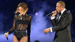 Le rappeur Jay-Z et et la chanteuse Beyonce aux Grammy Awards en 2014  (FREDERIC J. BROWN / AFP)