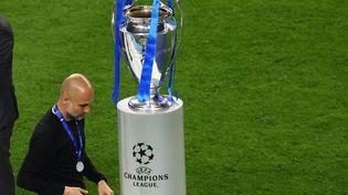 Pep Guardiola passe au pied de la Ligue des champions après la défaite de Manchester City en finale contre Chelsea, le 29 mai 2021. (MICHAEL STEELE / POOL)