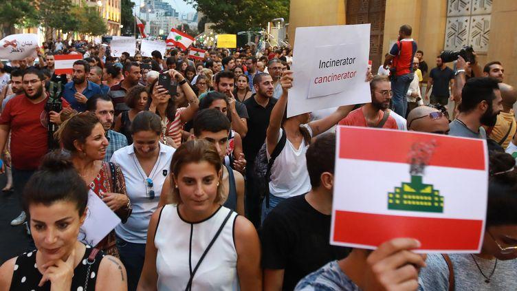 Des habitantes de Beyrouth au Liban manifestent pour l'environnement, en août 2018. (ANWAR AMRO / AFP)