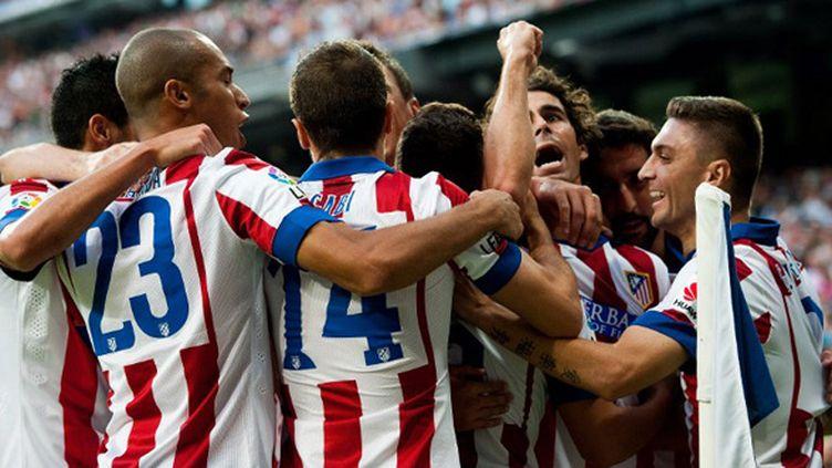 Les joueurs de l'Atletico Madrid fêtent leur victoire face au Real (DANI POZO / AFP)