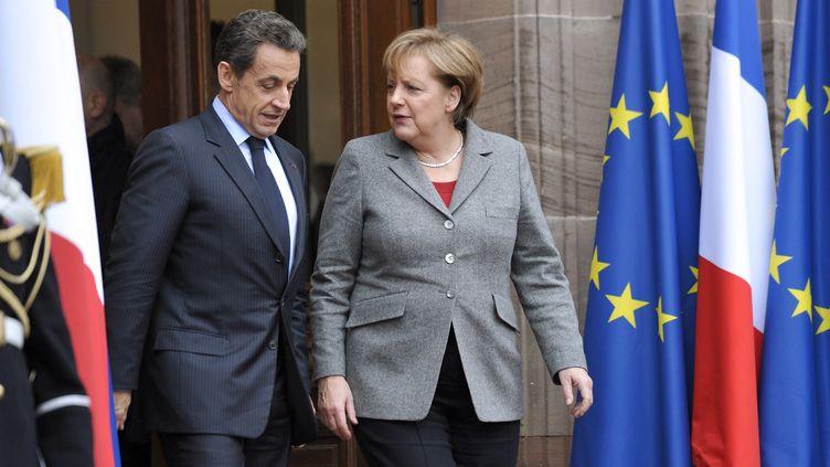 Nicolas Sarkozy et Angela Merkel après le mini sommet européen organisé le 24 novembre à Strasbourg. (ERIC FEFERBERG/AFP)