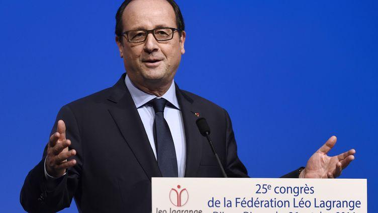 Le président de la République François Hollande à Dijon (Côte-d'Or), le 26 octobre 2014. (PHILIPPE DESMAZES / AFP)