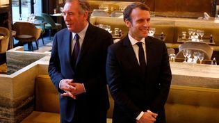 François Bayrou et Emmanuel Macron, au Palais de Tokyo, à Paris, le 23 février 2017. (CHARLES PLATIAU / REUTERS)