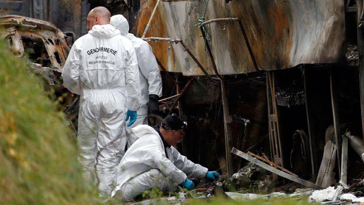 (La priorité des enquêteurs est l'identification des corps © REUTERS/Benoit Tessier)