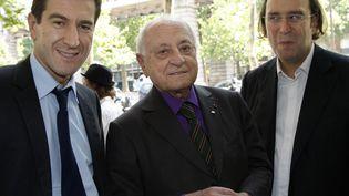 """Matthieu Pigasse, Pierre Bergé et Xavier Niel, actionnaires du """"Monde"""", le 24 juin 2010 à Paris. (THOMAS SAMSON / AFP)"""