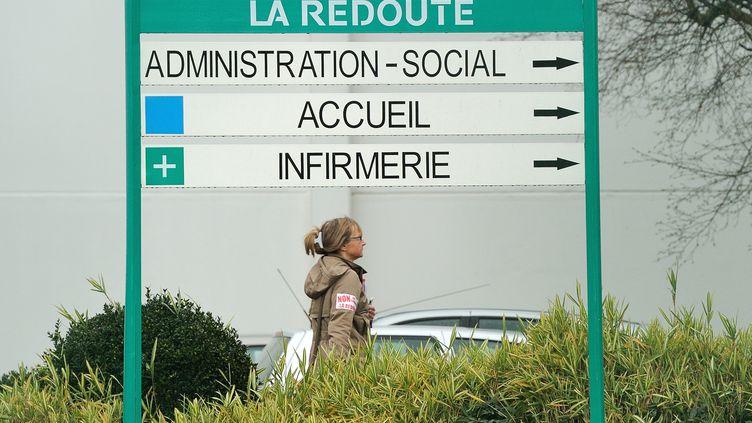 Une employée de La Redoute, à Wattrelos (Nord), le 14 janvier 2014. (PHILIPPE HUGUEN / AFP)