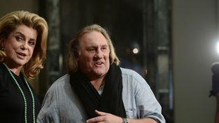 """Catherine Deneuve et Gérard Depardieu, tournage de """"Au service de sa Majesté"""", 2012  (JOHANNES EISELE / AFP)"""