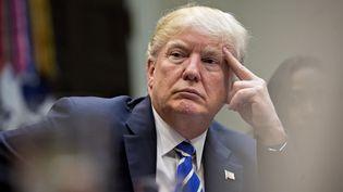 Donald Trump à la Maison Blanche, à Washington (Etats-Unis), le 27 mars 2017. (ANDREW HARRER / CNP / AFP)