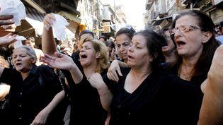 Damas, le 10 septembre 2013, Des femmes pleurent leurs morts lors des funérailles de trois jeunes chrétiens originaires de Maaloula 5syrie (ANWAR AMRO / AFP)