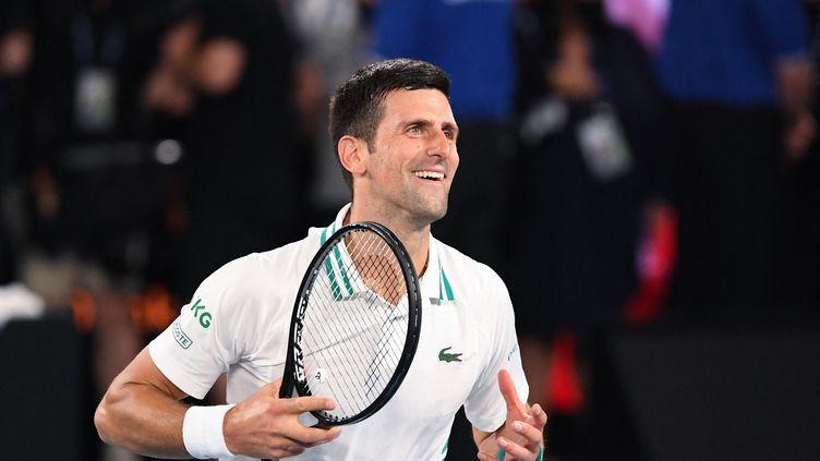 Novak Djokovic après sa victoire à l'Open d'Australie, à Melbourne, dimanche 21 février 2021. (WILLIAM WEST / AFP)