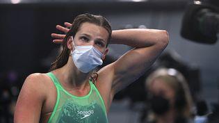 Marie Wattel après la finale du 100 mètres papillon aux Jeux olympiques de Tokyo le 26 juillet 2021. (OLI SCARFF / AFP)