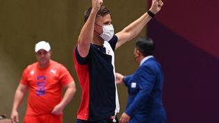 Jean Quiquampoix, champion olympique du tir rapide à 25 mètres aux Jeux de Tokyo. (TAUSEEF MUSTAFA / AFP)