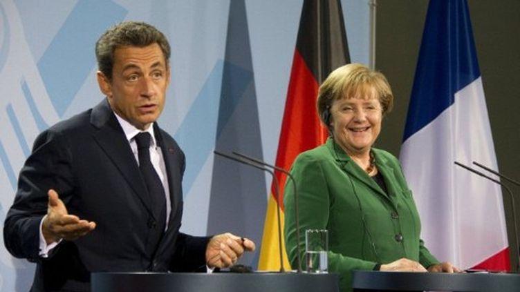Le président français aux cotés de la chancelière allemande, le 9 septembre 2011. (ODD ANDERSEN / AFP)