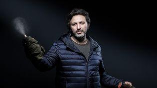 Le street-artiste français Christian Guerny, alias C215, le 10 mars 2020 à Paris (JOEL SAGET / AFP)
